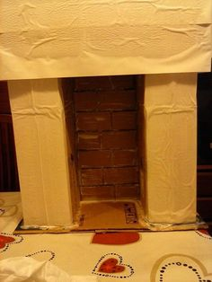 Chimenea decorativa navide a cartones forrados con papel - Hacer chimenea decorativa ...