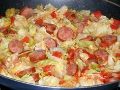 FRIED CABBAGE WITH SAUSAGE ... 1 stick butter or margarine, 1 small head of cabbage, chopped,  1 small onion, chopped, 1 lb polish sausage, sliced into round pieces, 1 (15 ounce) can diced tomatoes,  1/2 teaspoon salt, 1/2 teaspoon pepper, 1/4 of green pepper, few drops of hot sauce (opt.)  ...  Melt butter in lg skillet. Add cabbage, onion, & gr pepper, cook on med high for 5 min.  Add remaining ingredients, cover and simmer for 20 – 25 minutes. Makes about 8 servings.