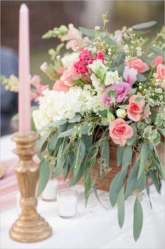 Romantic floral centerpiece ideas. #floralcenterpiece #weddingreception #weddingchicks Floral Design: Chelish Moore Florals ---> http://www.weddingchicks.com/2014/04/25/table-for-two-romantic-engagement/