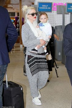 Hands full: Gwen Stefani headed to an airplane on Wednesday with her youngest son, Apollo,...