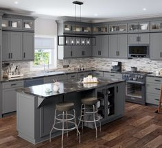 Bring a unique look to your new kitchen with Wilora Hawthorne Shaker Grey cabinets. The dark grey tone is neutral and versatile enough to pair with both warm and cool colors for hardware finishes, appliances, and other decor colors. This collection is great for creating industrial, farmhouse, modern, or transitional style kitchens. Who is Wilora? Wilora's collection of frameless and framed cabinets features a wide range of options and color choices to complete your home remodel. Choose from… Kitchen Cabinet Inspiration, Kitchen Cabinet Styles, Dark Grey Kitchen Cabinets, Modern Grey Kitchen, Dark Kitchen Countertops, Grey Kitchen Island, Grey Kitchen Designs, Kitchen Ideas With Grey Cabinets, Diy Painting Kitchen Cabinets