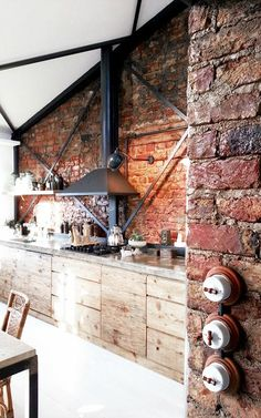= red brick, concrete benchtop and wood drawers