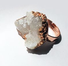 Made of real quartz crystal and faceted into a copper adjustable ring, this is the sparkliest ring you'll ever wear. Druzy is around 1.5 inches wide.  NOTE: Not waterproof. Must be taken care of and kept dry as it will be damaged by excessive water & moisture exposure.