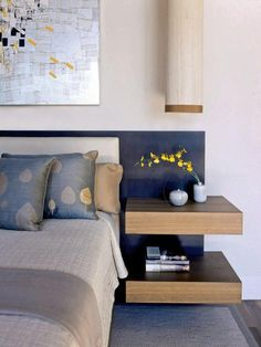 Build In Functionality - Tips for a Clutter-Free Bedroom Nightstand on HGTV . . . This cool headboard, with built in side tables actually conceals hidden drawers.