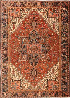 Trademark of Heriz/Serapi is often with an indigo central pendant on a tomato-red ground.   Heriz Serapi Persian Rug  `Heriz Rug, Persia, Early 20th Century - The trademark of Heriz/Serapi is often with an indigo central pendant on a tomato-red ground. The angular floral elements also define Heriz carpets from Northwest Persia. Always popular, these carpets have been in demand and continue to have a strong market.