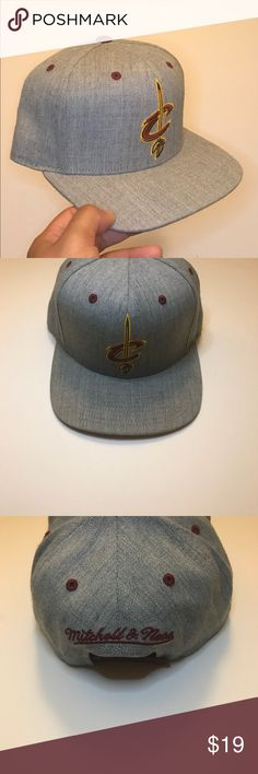 """Cleveland Cavaliers Mitchell & Ness SnapBack Cap Where My Cavs Fans...?  Represent The Cleveland Cavaliers In Style With This Mitchell &Ness Adjustable/SnapBack Cap.  This Hat Will Go Fast. Last One Available!  Pre-Owned/This Cap Was Rarely Worn.  High Quality Item In Great Condition!  """"Check Pictures Thoroughly""""  Buy With Confidence!  """"Free Fast U.S. Shipping!""""  Thank You For Your Support!  Happy Shopping! Mitchell & Ness Accessories Hats"""