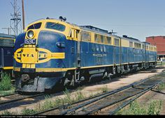 ATSF 159C Atchison, Topeka & Santa Fe (ATSF) FTA at Clovis, New Mexico -- A-B-A FT set 159C-177A-125L at Clovis, New Mexico, idles away the hours before its next assignment, September 1, 1965. A portion of the old Clovis ice house can be seen in the background.  Railroad: Atchison, Topeka & Santa Fe (ATSF) Locomotive: FTA Location: Clovis, New Mexico, USA Locomotive #: ATSF 159C Train ID: Unknown Photo Date: September 01, 1965