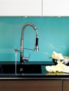 We like a bit of colour in a Funktional Kitchens' kitchen - this spray attachment tap looks great in front of this bright turquoise blue glass splashback. Kitchen Black Counter, Modern Kitchen Cabinets, Kitchen Taps, Kitchen Backsplash, Kitchen Ideas, Luxury Kitchen Design, Luxury Kitchens, Kitchen Planner, Wardrobe Furniture