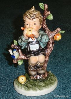 Up for sale is this Adorable An Apple A Day Goebel Hummel Figurine TMK6! This Hummel collectible features a young lad perched on a small apple tree. It is in MINT condition as you can see in the pictures with no chips, cracks, crazing or repairs and comes complete with original box! On the bottom it is identified as #403 with the TMK 6 trademark dated 1989! It would make a great addition to any Hummel collection! This Hummel stands about 6-3/8 tall. Just part of a HUGE quantity of Hummel...