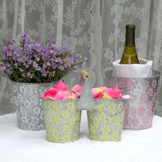 patterned galvanized buckets - see more galvanized ideas - http://rusticweddingchic.com/galvanized-buckets-for-wedding-flowers