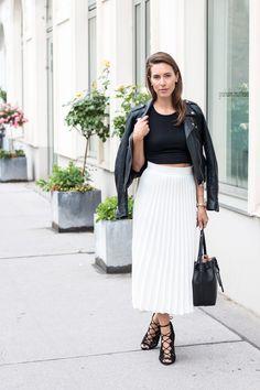 Black top, white pleated midi skirt & biker jacket