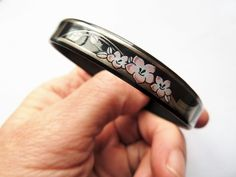 Gorgeous bangle created by the Michaela Frey Team in Austria. Black with characteristic Art Nouveau Jugenstil style pink flower design and
