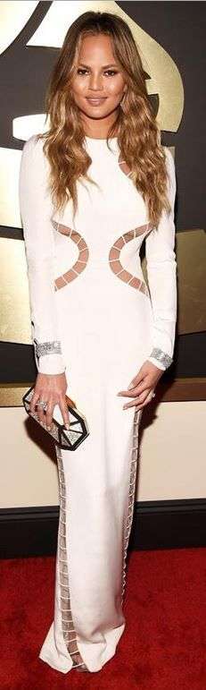 Chrissy Teigen: Dress – Emilio Pucci  Jewelry – Norman Silverman Diamonds