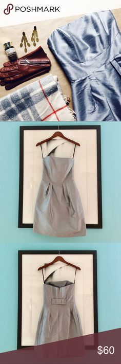 Alfred Sung Silver Strapless Dress Perfect for holiday fêtes! A silver silk strapless dress with pockets and a cute bow detail in back. The bodice has boning, which keeps it on your body and your girls looking perky 😉 Worn once and dry cleaned. Size 6, but fits like a 2.   Don't like the price? 💸 Make me an offer with the button below! 👇🏻 Alfred Sung Dresses Strapless