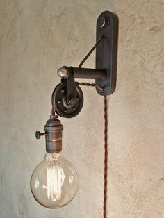 Industrial Pulley Sconce Lamp. Plug in. Instant ambiance. by IroncladIndustrial on Etsy