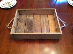 This primitive handmade tray is excellent for display or conventional use. The rope handles add to the rustic look and also offer an easy way to