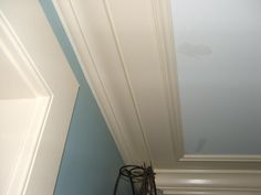 Trick for low ceiling- place molding on ceiling to draw eye up without making wall look shorter.