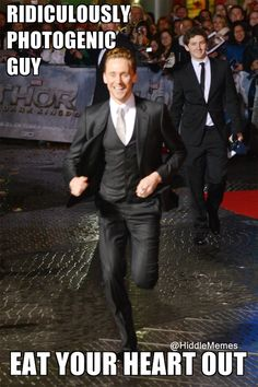 That's right!!! There's only one man who can look amazing running in a freaking suit - Tom Hiddleston!! Let's face it- he'd make a potato sack look hot:)