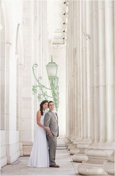Classic white columns at the Byron C. White Courthouse make for nice autumn wedding day portraits in Denver Colorado. - April O'Hare Photography http://www.apriloharephotography.com #DenverWedding