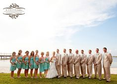 Aqua color dresses for the bridesmaids and ties for the groomsmen. Photograph by Kansas Studios