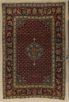 Carpet  Date:     ca. 1550 Geography:     Egypt, Cairo Medium:     Wool (warp, weft and pile); asymmetrically knotted pile Dimensions:     Textile: H. 79 in. (200.7 cm) W. 48 in. (121.9 cm) Mount: H. 84 3/4 in. (215.3cm) W. 55 3/4 in. (141.6 cm) D. 1/2 in. (1.3 cm)