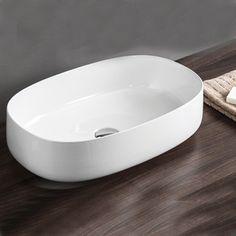 Vasque oblongue 55 x35 cm en céramique blanche à poser sur plan de toilette ou meuble de salle de bain. Découvrez l'ensemble des produits de la collection Cognac disponible dans plusieurs dimensions et coloris sur Espritdubain.com