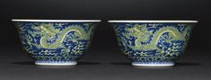 A FINE PAIR OF BLUE AND YELLOW 'DRAGON' BOWLS QIANLONG SEAL MARKS AND PERIOD Estimation 60,000 — 80,000 GBP