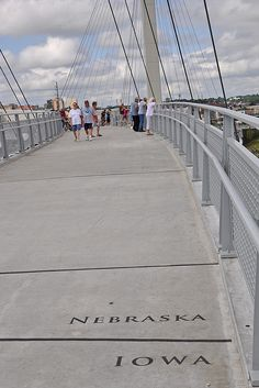 The Nebraska/Iowa state line is plainly marked on the Bob Kerry Pedestrian Bridge over the Missouri River connecting Omaha, Nebraska, and Council Bluffs, Iowa. Live in the Omaha Nebraska area and need a roof repair or Reroof Ceck out our website Great Places, Places To See, Lincoln Nebraska, Nebraska Omaha, Nebraska State, Mississippi, Council Bluffs Iowa, Rio, Missouri River