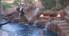 Google Image Result for http://www.genie-backyard-patio.com/wp-content/gallery/fire-features/4-fire-bowls-in-pool-design-concept.jpg