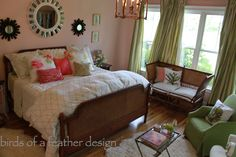 This master bedroom is decorated in soothing Spring colors. The pale pink walls have a hint of peach to create a sophisticated hue. The Sunburst mirrors over the bed are HomeGoods finds and bounce light around the room. The mirrored bamboo table finishes off the sitting area.