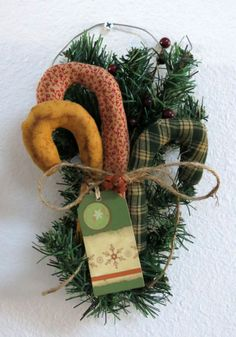 Trio of primitive candy canes designed to be a wall hanging.