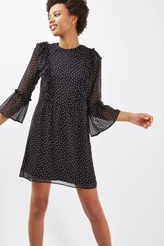 Add a touch of pretty to your wardrobe in this spot print sleeve dress, featuring ruffle detail to the shoulders and flute sleeves. In a girlie mini cut, team with black ankle boots to add some edge to the look. #Topshop