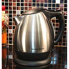 Invite your friends over for a tasty cup of hot tea brewed in this shiny Hamilton Beach electric kettle. This durable stainless steel kettle features a sleek design and cord-free serving. Make up to 10 cups of your favorite beverage in this kettle. Apartment Home Living, Stainless Steel Kettle, Tea Tray, Electrical Appliances, Hamilton Beach, Brewing Tea, Heating Element, Drinking Water, Kitchen Gadgets