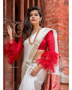 This season ruffle sleeves and bell sleeves saree blouse designs are in trend and you can't just ignore them. Take a look at some of the amazing bell sleeves and ruffle sleeves blouse designs that you can add to your wardrobe. Stylish Blouse Design, Fancy Blouse Designs, Bridal Blouse Designs, Blouse Neck Designs, Sleeve Designs, Trendy Sarees, Stylish Sarees, Fancy Sarees, Designer Blouse Patterns