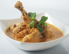Chicken curry with richness of almonds and cream.