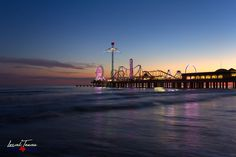 As the last of daylight fades from the sky, the Pleasure Pier in Galveston begins to glow. Photographic Prints: Photographic prints are available in two finishes – matte and glossy. Great Photos, Cool Pictures, Create Picture, Types Of Lighting, Galveston, Unique Photo, Photographic Prints, Seattle Skyline, Glow