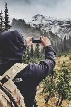 love this photo taking a photo of a photo taker! travel mountains hiking backpacking