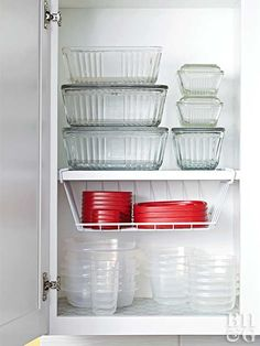 Genius Food Storage Container Hacks Storage and Organization There are a lot of Genius Food Storage Container Hacks out there and I have to admit that there is no need to be envious of them. They're probably fou. Large Food Storage Containers, Container Organization, Plastic Storage, Organization Ideas, Storage Ideas, Lid Storage, Kitchen Cupboard Organization, Kitchen Storage Hacks, Kitchen Cupboards