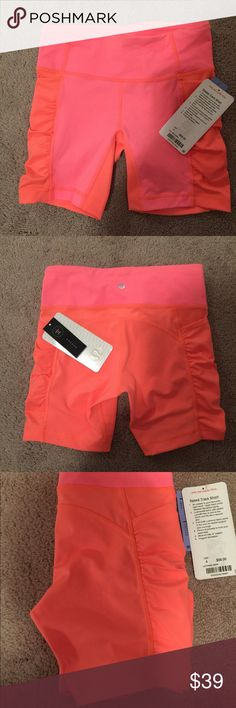 "lululemon Althletica Speed Track Short Lululemon Speed Track Short in the color orange is super cute with any active top for exercise or running.  Detail & Care: Front:77% nylon/23% lycra elastane, Back:70% polyester/30% lycra elastane.  Medium rise, 6"" inseam, hugged sensation, plenty of pockets to hold your essentials.  Note: the image show the two shade of orange or pink but the lighter shade of orange is almost the same shade of orange(only a bit lighter, the two shades are almost…"