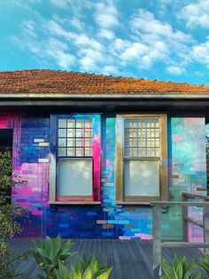 Vibrant abstract exterior mural that covers a residential home with a bright color palette of mostly pink, blue and metallic. Pops of color highlight the bricks and contrast with the garden foliage. Meubles Peints Style Funky, Exterior Design, Interior And Exterior, Brick Wall Background, Paint Designs, House Painting, Mural Painting, My Dream Home, Future House