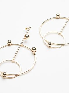 Drop Down Double Hoops | Make an eye-catching statement with these galaxy-inspired drop down double hoops.