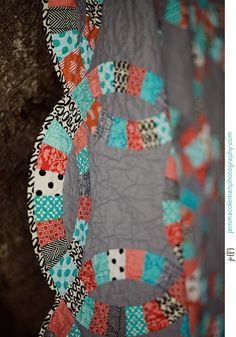 I kind of love the scalloped edges.  Double Wedding Ring Quilt by Elena @ Hot Pink Stitches, via Flickr