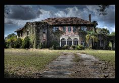 Howey Mansion - Howey-in-the-Hills, Lake County, Florida. The exquisite and stately mansion built by the small town's founder in 1925 sits in ruins due to a continuing legal battle. http://articles.orlandosentinel.com/2012-08-24/news/os-lk-lauren-ritchie-howey-mansion-20120824_1_howey-mansion-william-j-howey-australian-craftsman