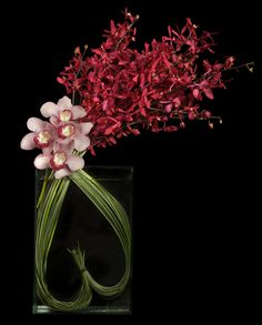 Grass Heart w/Orchids by   Ovando Floral and Event Design
