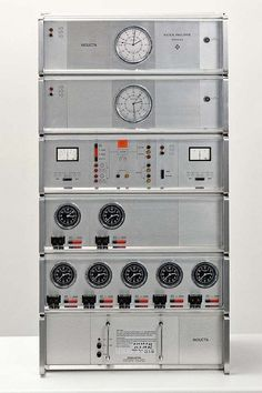 Patek Philippe, Genève, T3 Master Clock System, c. 1975. 3 clock units separately keep time. Each is equipped with a quartz - crystal oscillator. Times are compared by the control unit contained in unit C. If one of the 3 clock units shows a variation from the other 2, the unit with the wrong time is automatically switched off. For further precision, the system is synchronized by radio signal with the observatory Prangins in Genève. Local time for 7 different cities is kept on the 7 small…