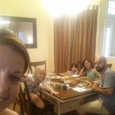 Our very own Sales Manager, Alicia, with her family & her DutchCrafters dining set!
