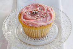 White chocolate ganache is the decadent topping to these melt in the mouth cupcakes.