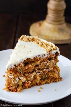 This Pineapple Carrot cake with Orange Cream Cheese Frosting is perfect for an Easter party! Moist carrot cake layers infused with pineapple and frosting with a sweet, tangy orange cream cheese. This spring inspired cake is sure to be a delight!