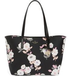 Romantic flowers bloom across this structured tote topped by smooth over-the-shoulder handles and accented with a 14-karat goldtone-plated Kate Spade charm.