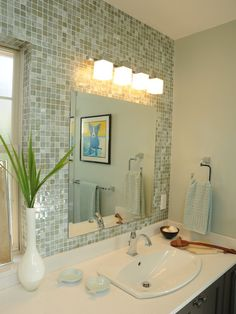 Have you ever thought about using mosaic tile on an entire wall in the bathroom?  We love this look with the tile behind the mirrors.